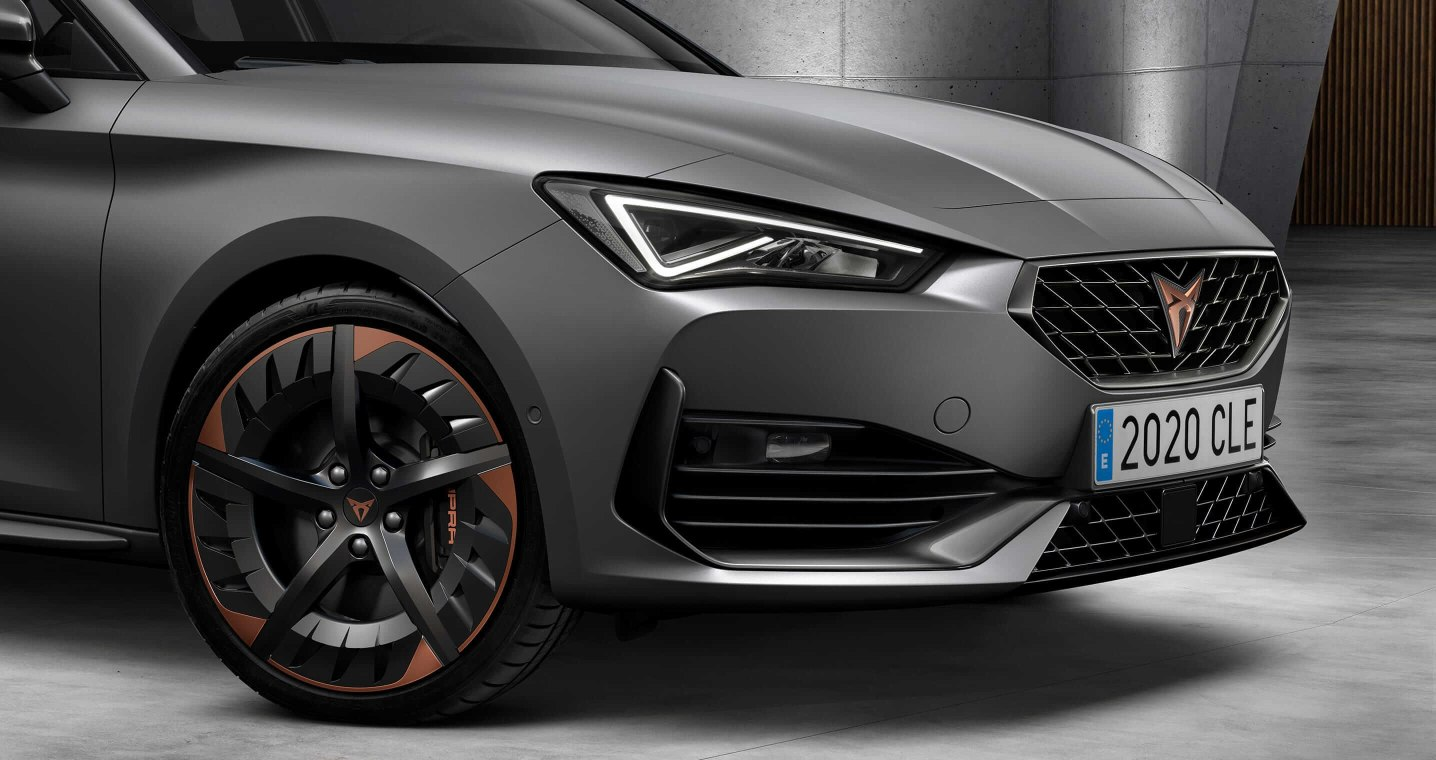 new CUPRA Leon five door compact sports car rhodium grey close up of front grille and Aero wheels
