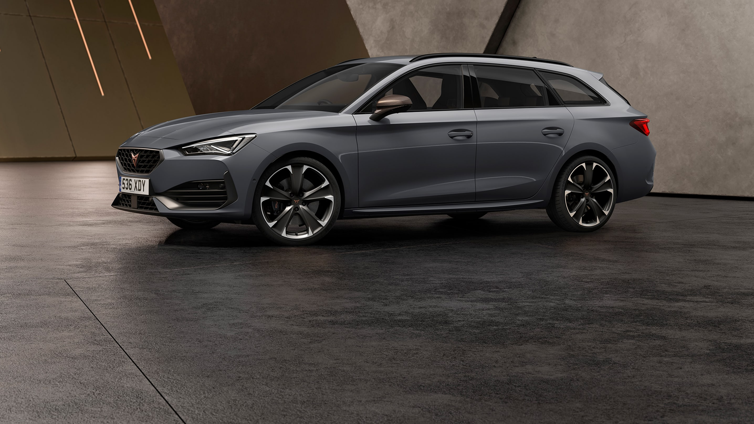 new CUPRA Leon Estate e-HYBRID Family Sports Car in graphene grey charging sideview
